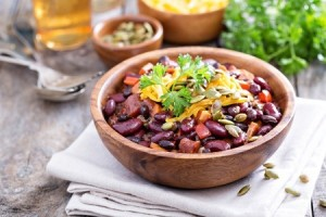 45659606 - vegetarian chili with red and black beans, cheddar and pumpkin seeds